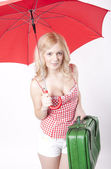 Young attractive woman with red umbrella — Stock Photo