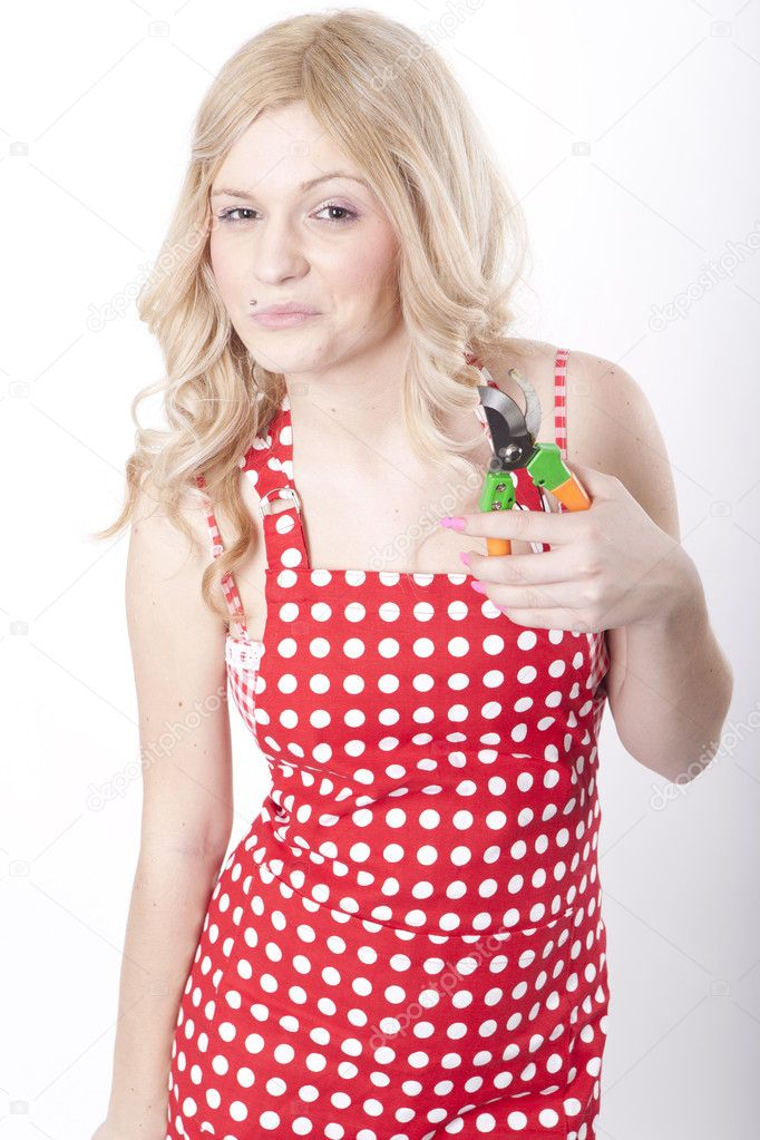 Portrait of a young attractive woman holding a garden tool. — Stock Photo #11677618