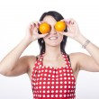 Young attractive woman holding two oranges — Stock Photo #11851514