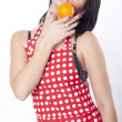 Young attractive woman holding orange — Stock Photo #11851524