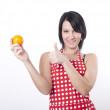 Young attractive woman holding orange — Stock Photo #11851531