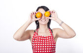 Young attractive woman holding two oranges — Stock Photo