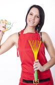 Young attractive woman with gardening tools — Stock Photo