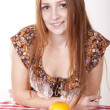 Young beautiful girl eating orange — Stock Photo #12091341