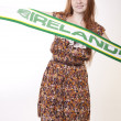 Young beautiful female ireland fan — Stock Photo