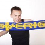 Young beautiful male sweden fan — Stock Photo