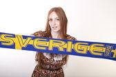 Young beautiful female sweden fan — Stock fotografie