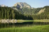 Mountain landscape with lake — Stock Photo