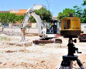 Excavator with hammer e laser level — Stock Photo