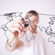 Young man drawing a world map — Stock Photo