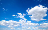 Clouds and clear blue sky — Stock Photo