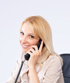 Portrait of a young blonde girl on the phone — Stock Photo