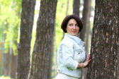 Cute woman in the park — Stock Photo