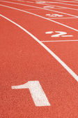 Running track curve with lane numbers — Stock Photo