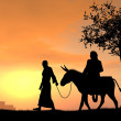 Joseph and Mary Travel to Bethlehem - Stock Photo