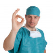Doctor in scrubs with okay gesture — Stock Photo