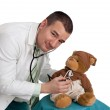 Male pediatrician and teddy bear — Stock Photo