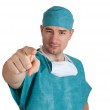 Doctor in scrubs pointing at you. — Stock Photo