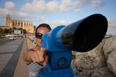 Young woman with telescope — Stock Photo