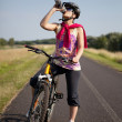 Woman on bike — Stock Photo