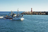 PENICHE, PORTUGAL - JULY 9: View of fishing boat returning to harbor July 9, 2012 in Peniche, Portugal — Stock Photo