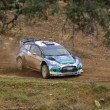 ALGARVE, PORTUGAL - MARCH 31: Petter Solberg (NOR) driving is Ford Fiest RS WRC in Rally de Portugal 2012 on March 31, 2012 in Algarve, Portugal - Stock Photo