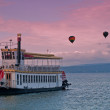 Stock Photo: Steamboat and hot air balloons