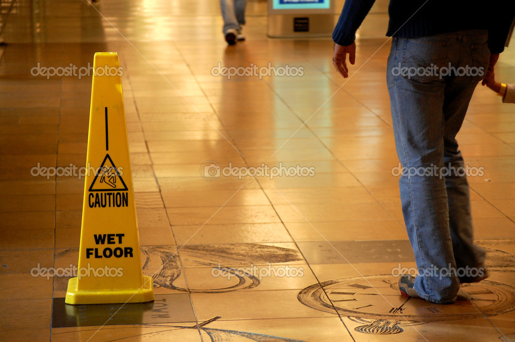 Caution Wet Floor sign in a shopping mall — Stock Photo #11701492