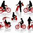 Silhouettes of and children on bicycles — Stock Vector