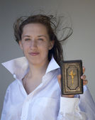 Girl with a Bible — Stock Photo