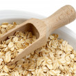 Oats with spatula — Stock Photo