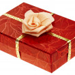 Stock Photo: Red boxed gift with rose ribbon