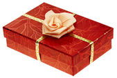 A red boxed gift with rose ribbon — Stock Photo