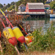 Lobster buoys and traps - Stock Photo