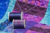 Quilt with quilting thread — 图库照片