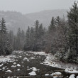 Winter first snow scenery with mountain river - Stockfoto