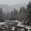 Winter first snow scenery with mountain river - Stok fotoğraf