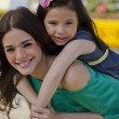 Portrait of young beautiful mother and her daughter — Stock Photo
