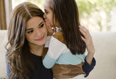 Little girl telling her mother a secret — Stock Photo