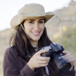 Young beautiful woman taking pictures in a hiking trip - Стоковая фотография
