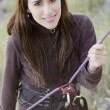 Young woman ready to rappel down a mountain - Foto Stock