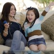 Young beautiful mother listening to music with her daughter — Stock Photo #11446493