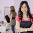 Portrait of a cute business owner in a beauty salon - Stock Photo