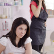 Female hairdresser busy on a call while customer is in a hurry — Stock Photo