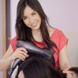 Female hairdresser drying client's hair — Stock Photo #11446891