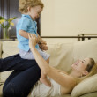 Cute young mother and son having fun together — Stock Photo #11446964