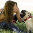 Young beautiful woman with her pug dog at the park — Stock Photo #11447065