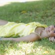 Stock Photo: Cute girl relaxing at the park