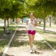 Cute young woman running at the park — Stock Photo