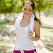 Young beautiful woman drinking water after exercising — Stock Photo